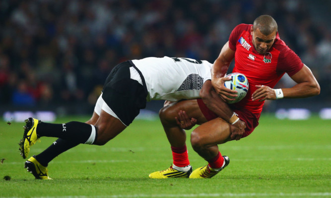 A tough tackle during the England v Fiji match at the Rugby World Cup.