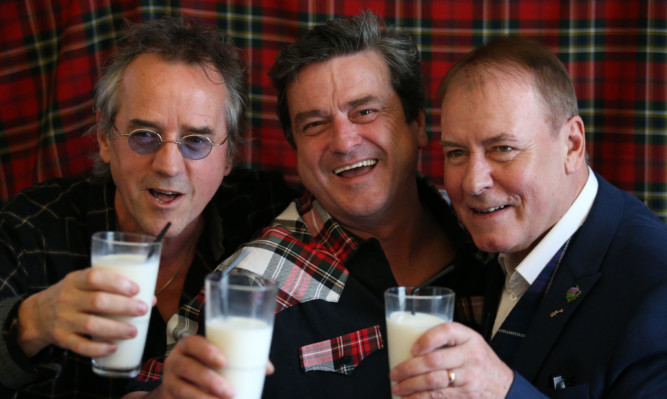 Bay City Rollers (left to right)  Stuart Wood, Les McKeown and Alan Longmuir toast with milk as they  make the announcement of their reunion at Central Hotel in Glasgow.