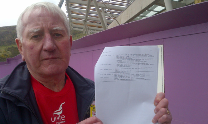 Francie Graham with the document confirming he was on a blacklist.