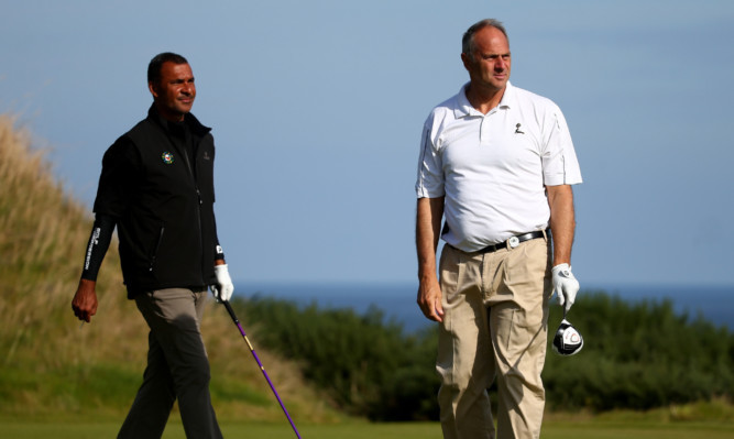 Sir Steve Redgrave (right) with Ruud Gullit at the 2014 Alfred Dunhill Links Championship at the Kingsbarns Golf Club