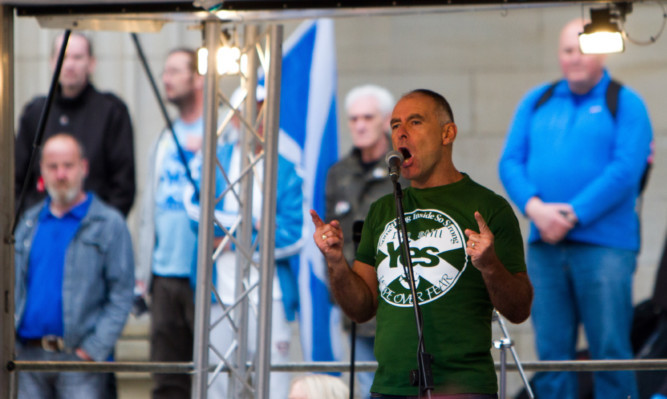 Tommy Sheridan speaking on stage.
