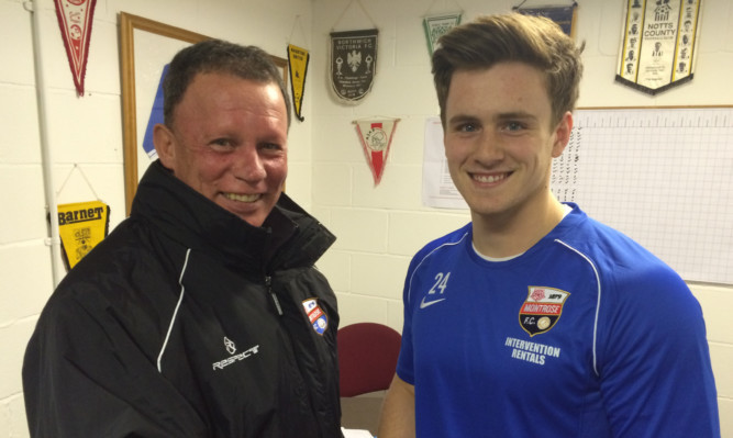 Adam Harwood with Montrose assistant manager John Holt.
