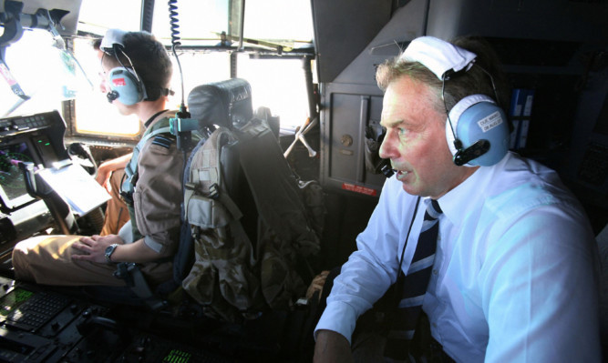 Tony Blair travels in the cockpit of a C130 Hercules from Baghdad to Basra in Iraq in 2007.