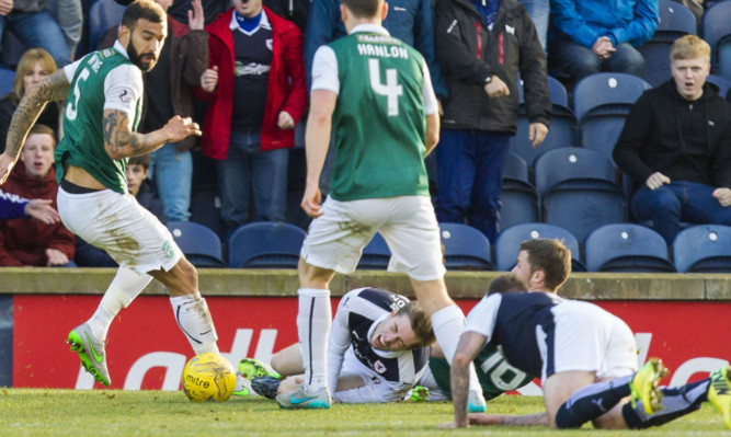 Craig Wighton (below centre) grimaces in pain after a challenge from Lewis Stevenson.
