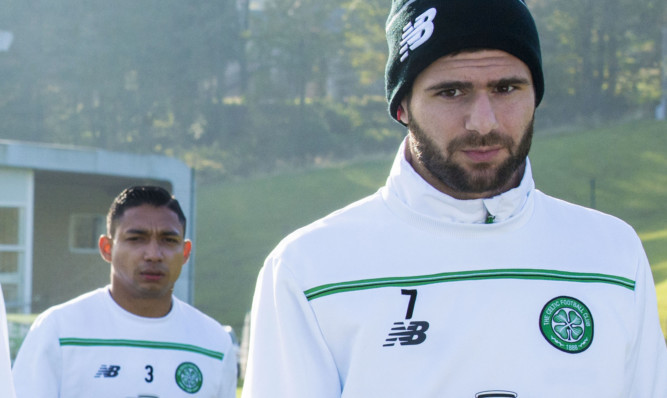 Celtic's Nadir Ciftci (right) and Emilio Izaguirre in training.