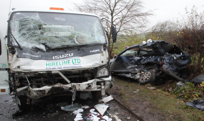 The Isuzu lorry and Mr Bissetts car immediately after the fatal accident.