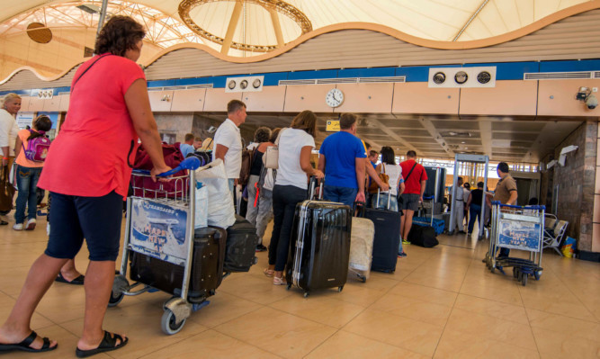 Passengers hoping to find flights home from Sharm el-Sheikh Airport.