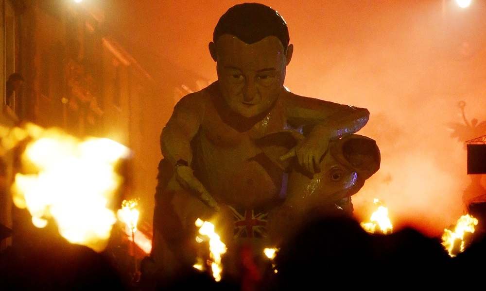 An effigy of Prime Minister David Cameron is paraded through the town of Lewes in East Sussex where an annual bonfire night procession is held by the Lewes Bonfire Societies. PRESS ASSOCIATION Photo. Picture date: Thursday November 5, 2015. Photo credit should read: Gareth Fuller/PA Wire