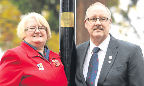 Pte Ferns mum Christine and her husband Ian beside the plaque dedicated to Marc.