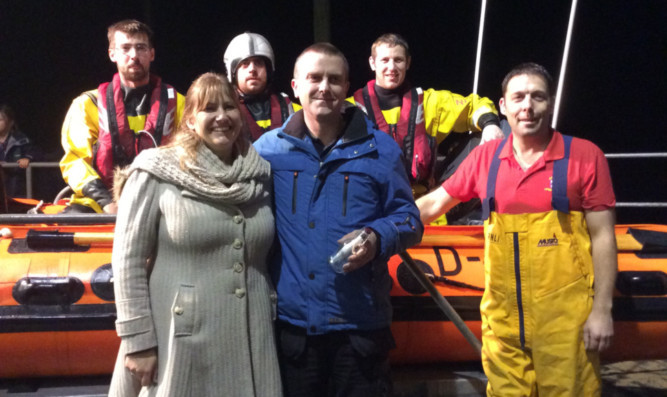 Newly-engaged Nicky Titchener and Grant Norrie with members of Anstruther lifeboat crew.