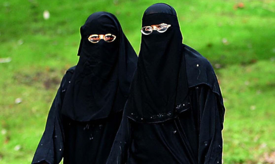 Muslim women out doing their shopping in Blackburn wearing the Niqab.