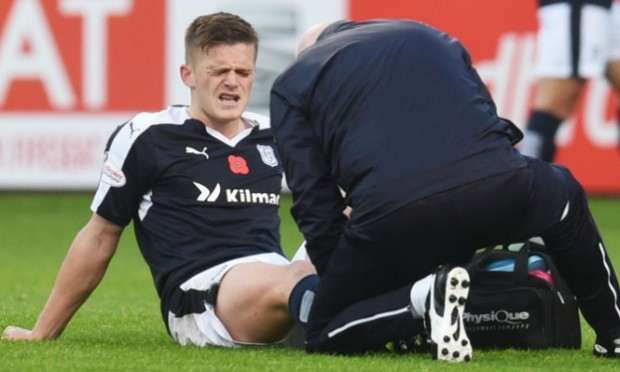 Dundee's Rhys Healey picks up an injury during the Partick game.