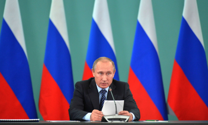 Russian President Vladimir Putin speaks during his late-night meeting with the heads of Russia's sports federations.