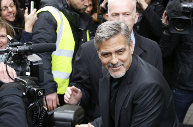 Hollywood superstar George Clooney has been given a warm welcome as he arrived in Edinburgh - to visit a sandwich shop. A large crowd gathered in Rose Street and cheered as the A-lister stepped out of his chauffeur-driven car. Clooney was visiting the Social Bite cafe to meet members of staff who were once homeless but now have jobs in the chain of shops which donates all its profits to charity.