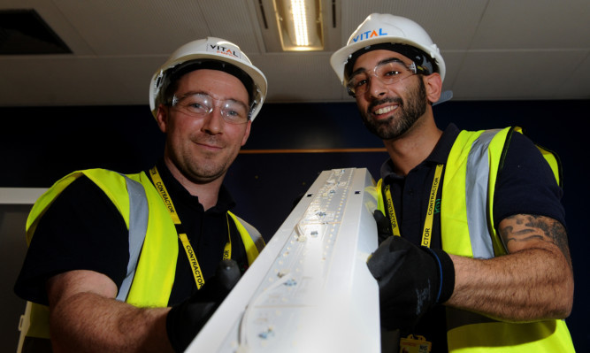 fROM LEFT: Stu Wright and Mario Varnava from Vital Energi fitting the new system at Ninewells Hospital.