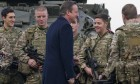 David Cameron talks with soldiers from the Royal Welsh Infantry. He has promised a big increase in spending, especially on Special Forces and counter-terrorism.