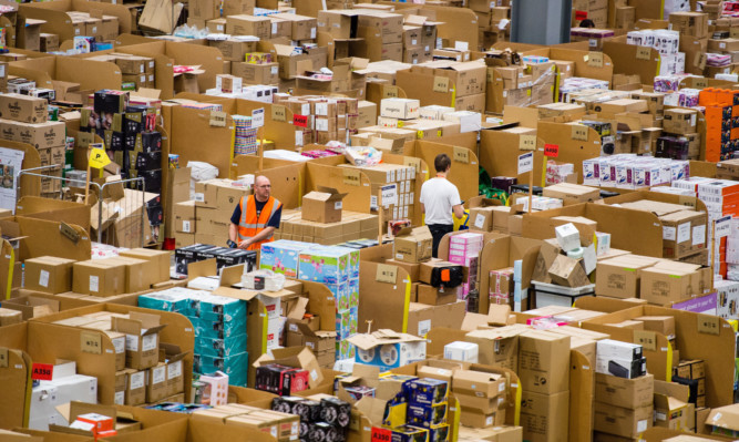 Staff at a fulfilment centre for Amazon.co.uk, which expects to have its busiest ever day on Friday.