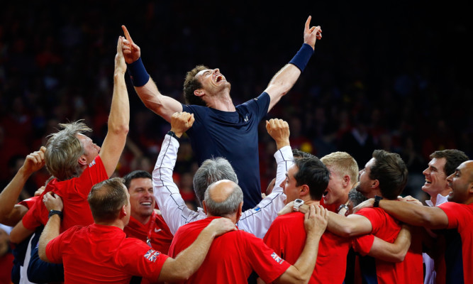 Andy Murray celebrates with his team-mates after winning his singles match to win the Davis Cup for Great Britain.