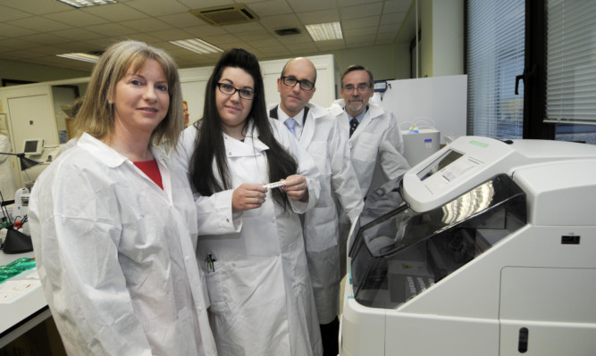 From left: Health Secretary Shona Robison, Biomedical Scientist Cara Steven, Dr Craig Mowat, and Prof Bob Steele at Ninewells Hospital.