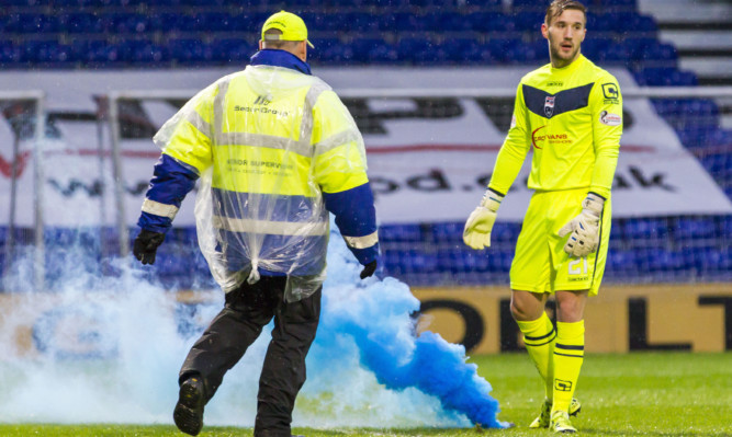 A flare was thrown on to the pitch during St Johnstone's match with Ross County.