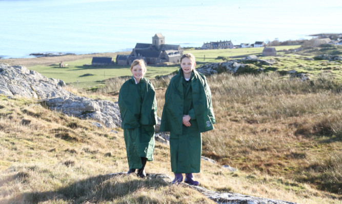 From left: Iona Morgan and Iona Billinge, singing Iona on the island of Iona.