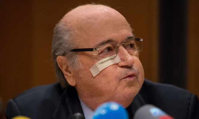 Sepp Blatter attends a press conference as reaction to his banishment for eight years by the FIFA ethics committee.