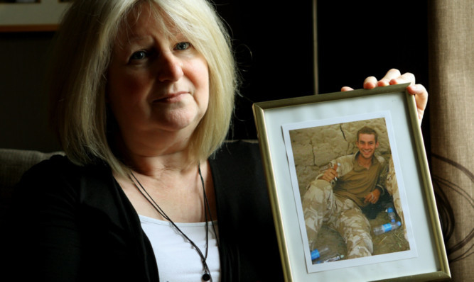 June Black, with her favourite photo of her son Aaron, who committed suicide whilst suffering from Post Traumatic Stress Disorder.
