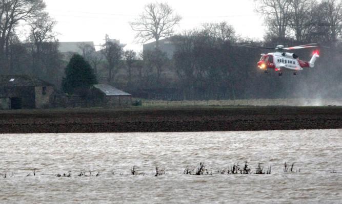 The helicopter rescue near Boglea Farm at Alyth.