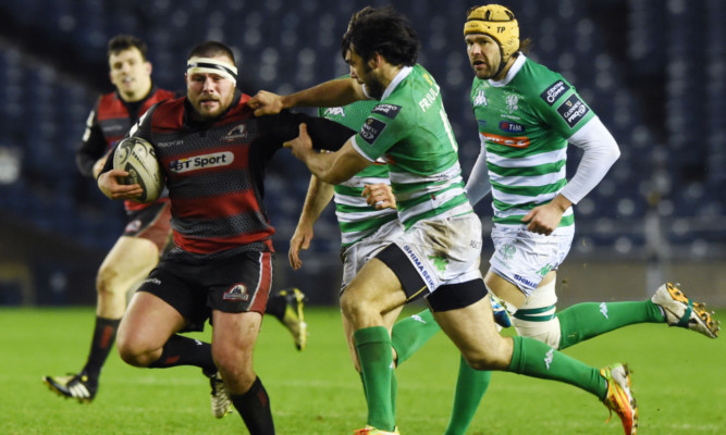 Rory Sutherland charges through the Treviso defence at Murrayfield.