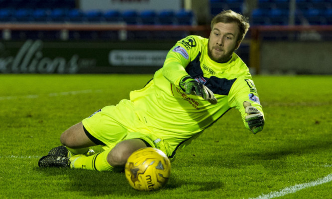 County keeper Scott Fox: praised by his manager for keeping his side in the tie with Dunfermline.