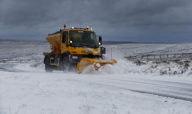 A snow plough clears Snow in Northumnerland on the road between Allendale and Nenthead .....PA Photo Owen Humphreys