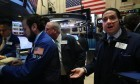 Anxious faces on New Yorks stock exchange as predictions of tough times ahead sink in.