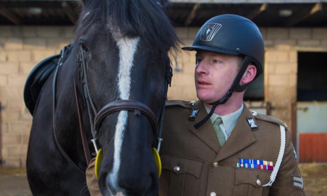Royal Scots Dragoon Guards mascot and drum horse 'Talavera' with regimental groom Lance Corporal Calum Jones at Edenside Stables, Guardbridge