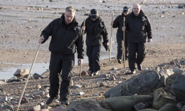 Police were searched the beach at Lunan Bay after the discovery.
