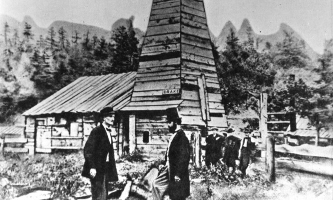 Colonel Edwin Laurentine Drake (1819-1880), in top hat, talks to an engineer at his oil well at Titusville, Pennsylvania.