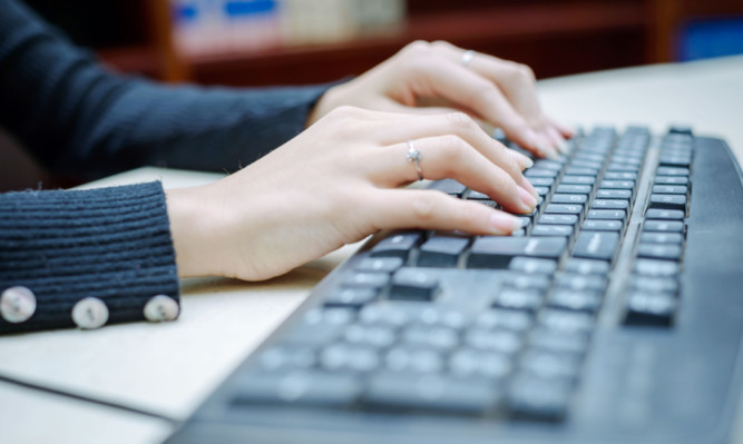 Closeup portrait of woman's hand typing on computer keyboard