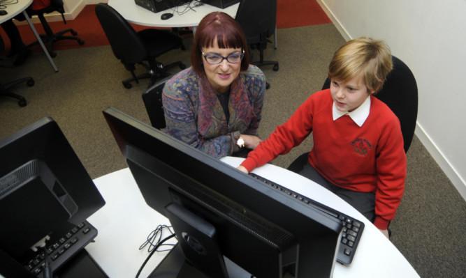 Scottish Education Secretary Angela Constance with Fraser Gray, 11, from Monikie Primary School.