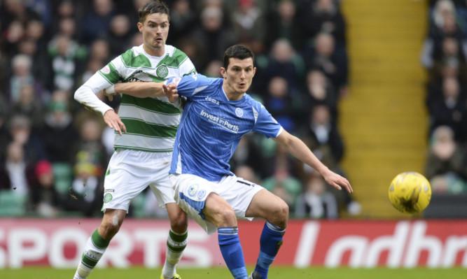 Celtic's Mikael Lustig battles with Graham Cummins of Saints.