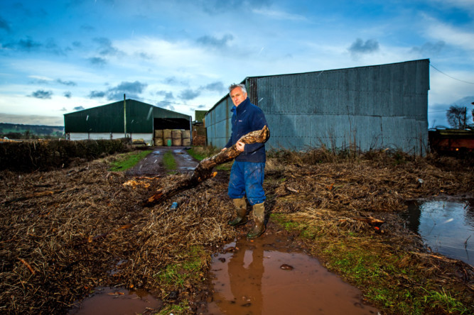 Steve MacDougall, Courier, Haugh of Aberuthven Farm, Aberuthven. Picture of farmer James Haggart to accompany story about his calls for SEPA to take action after his farm was badly damaged after recent flooding. Pictured, Mr Haggart clearing debris from the recent flood.