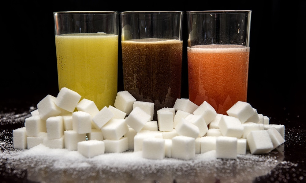 "File photo dated 22/07/15 of carbonated drinks surrounded by sugar cubes. The World Health Organisation (WHO) has joined those calling for a ""sugar tax"" on soft drinks in a major report on childhood obesity. PRESS ASSOCIATION Photo. Issue date: Monday January 25, 2016. The move will undoubtedly increase pressure on the Government as it prepares to issue its own strategy for tackling obesity in the UK. See PA story HEALTH Sugar. Photo credit should read: Anthony Devlin/PA Wire"