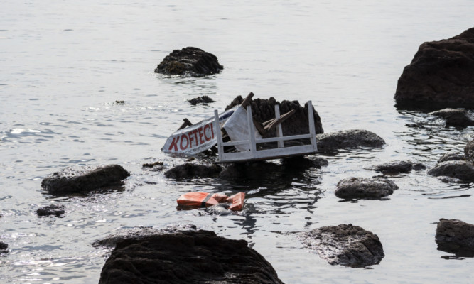 The remains of a boat that was carrying migrants seen on the shoreline near the Aegean town of Ayvacik, Turkey, at the weekend.