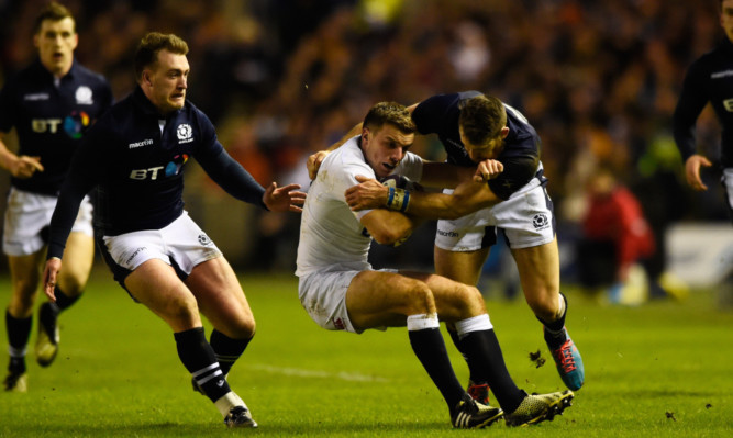 Tommy Seymour and Stuart Hogg catch George Ford in possession in the Calcutta Cup match.