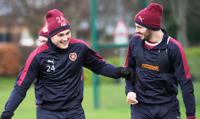 John Souttar, left, enjoys a laugh with Hearts team-mate Callum Paterson at training.