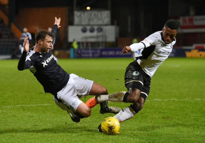 Dundee's Rory Loy challenges for the ball with St Johnstone's Darnell Fisher.