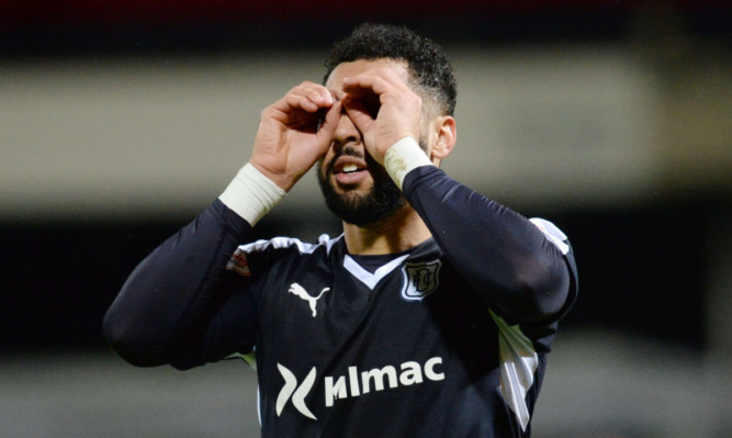 Kane Hemmings celebrates his second of the night  and his 18th of the season  as Dundee go fifth in the Ladbrokes Premiership.