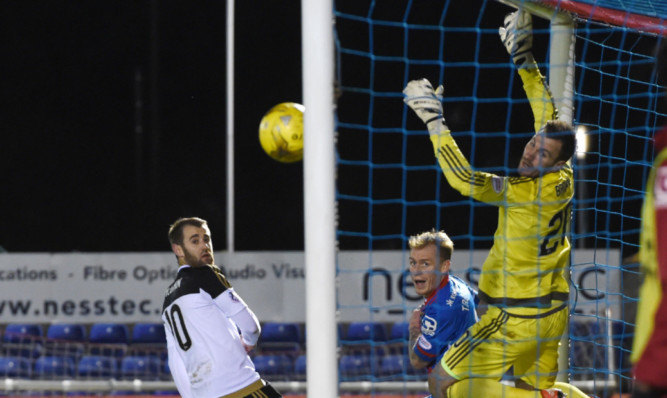 Carl Tremarcos header beats Dons keeper Scott Brown to make it 3-1 for Inverness.