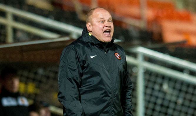 Dundee United manager Mixu Paatelainen gives orders to his players.