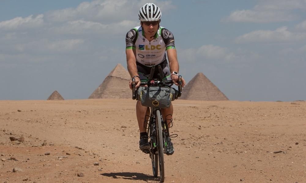 Scottish adventurer Mark Beaumont cycles his Koga bicycle in front of the Pyramids of Giza, the day before departing on his Africa Solo expedition to try and set the Cairo to Cape Town World (speed) record, in Cairo, Egypt, 9 April 2015. The current World Record stands at 59days 8 hours, Mark plans to do the 10,000km distance, through 8 African countries, in sub-50 days. For further information please refer to www.markbeaumontonline.com or Telephone Mark on +44-7979-836473.