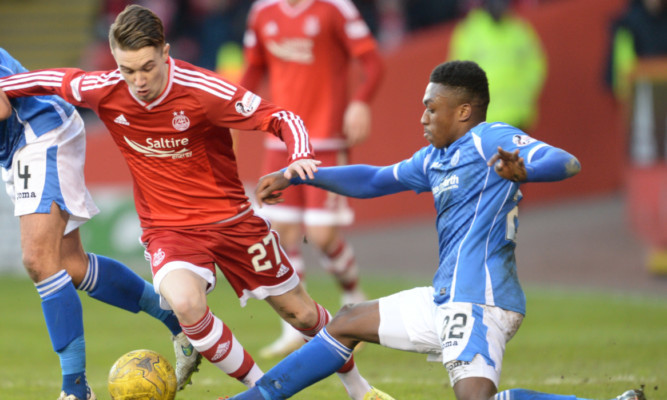 Darnell Fisher in action against Aberdeen.