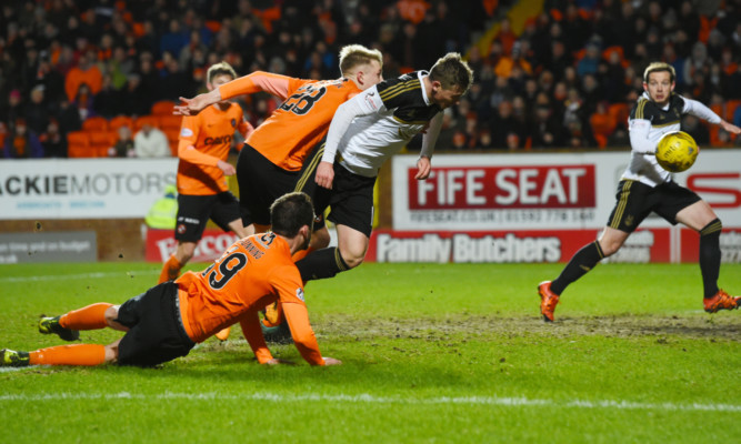 Simon Church (second from right) scores for Aberdeen.